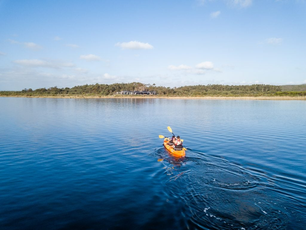 Guests kayaking at Perivoli Lagoon House